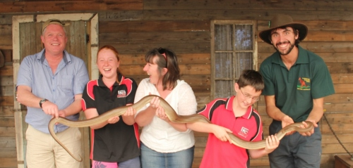 The Taylor family on a recent trip to Australia (Lachlan likes snakes but Thomas obviously doesn't!)