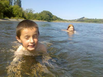 Sarah and Lachlan cool off in the Tukituki River