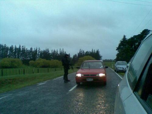 A member of the AOS talks to a motorist at the Takapau/Ormondville Rd and Otawhao Rd intersection