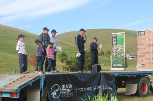 The Ritchie family on the left with Silver Fern Farms director Angus Mabin speaking and field day facilitator Roy Fraser on the right